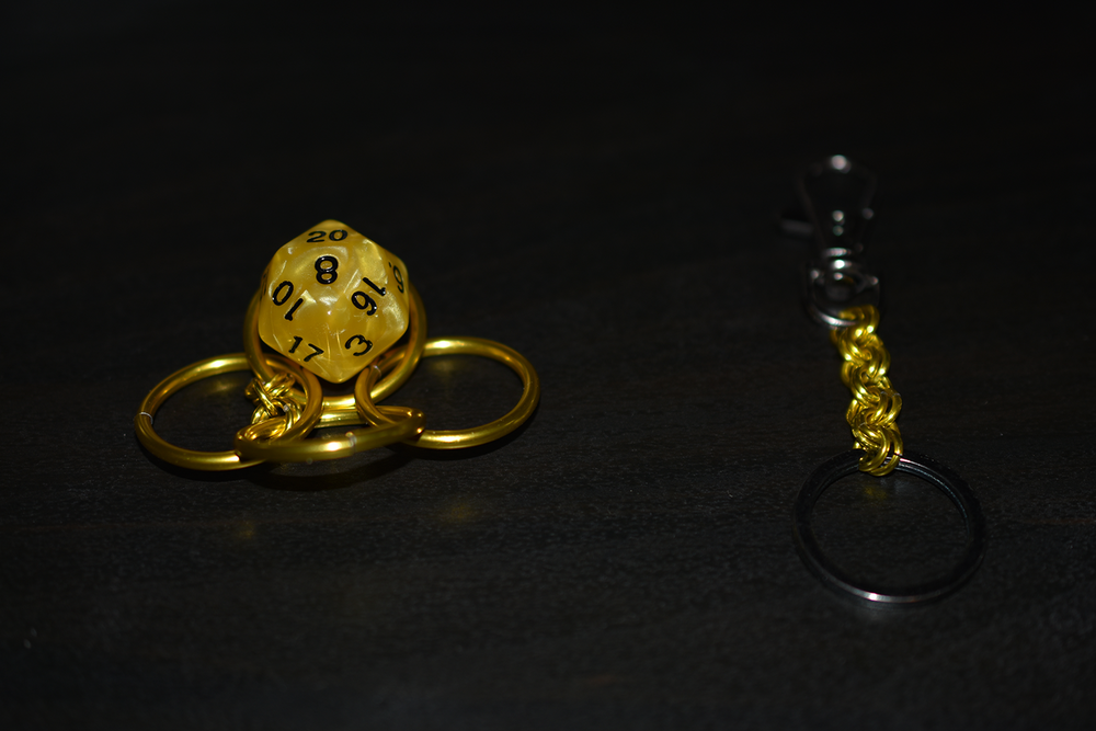 Step 4 - Place the D20 on one of the rings connected by small rings (same rings mentioned in step two).