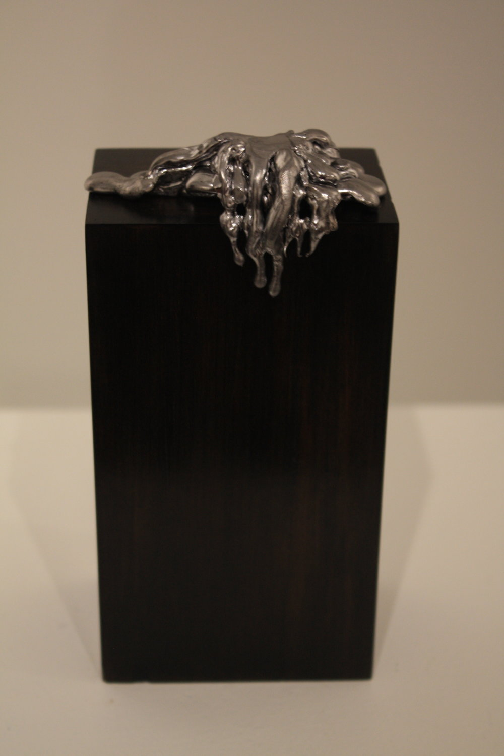 Overflow - 2016               Lead, ebonised wood16 x 8 x 5 cmSOLD