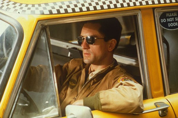 Taxi Driver (1976) - Amanda welcomes new guest, Sean, to join her and frequent guests Colleen, Stephen and Tim to discuss the Martin Scorsese classic, Taxi Driver. Sean proposes that maybe Travis Bickle is Batman, Colleen isn't a fan of the film until the last few minutes, Stephen wants to take Cybill Shepherd on a date but not to a porn theatre, Tim has an interesting read on the role of Bickel's parents, and Amanda shares some critics' theories about the end of the film.