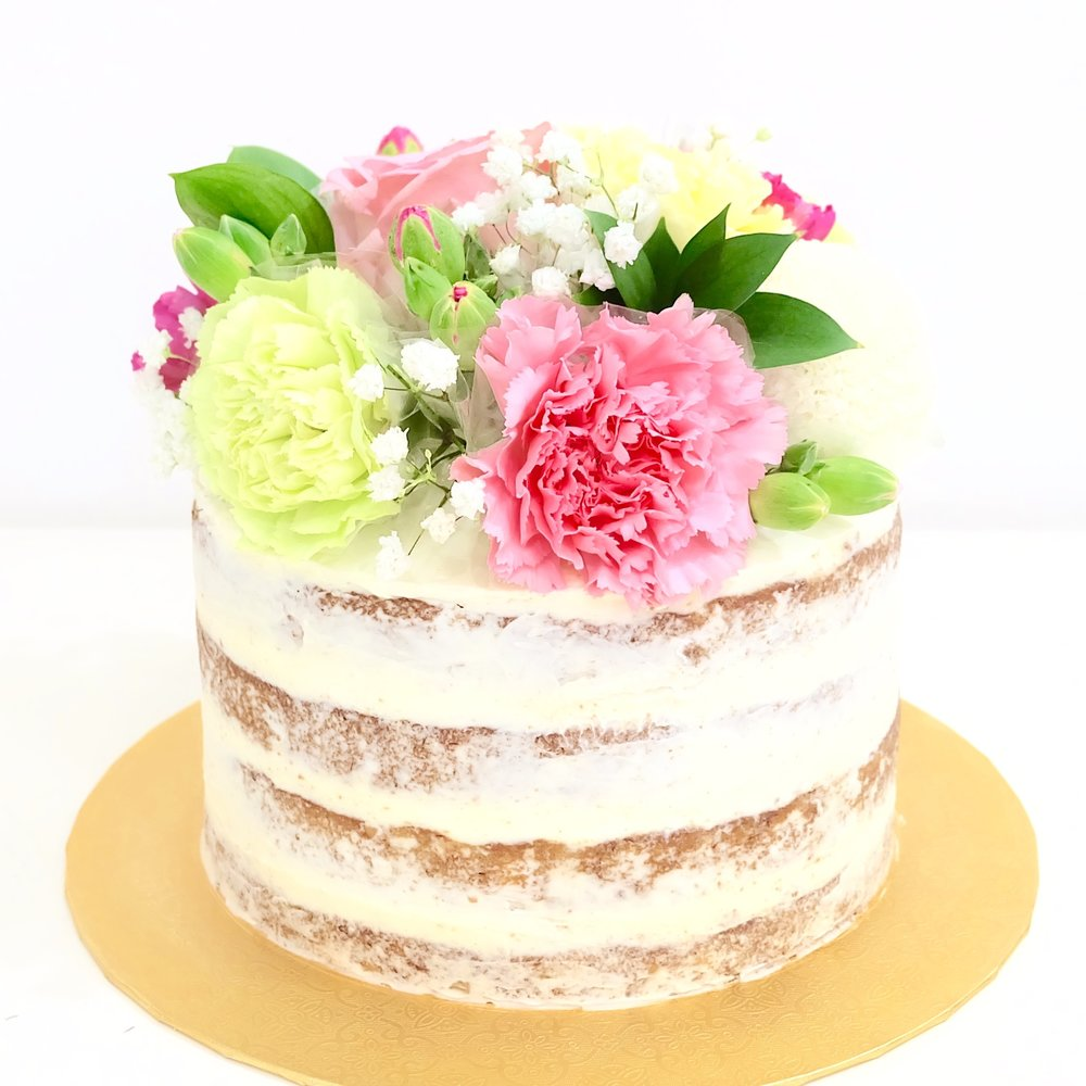 Fresh Flower Cake - Ø 18 cm - Rp.800.000,-Ø22 cm - Rp. 1.200.000,-Ø26 cm - Rp. 1.600.000,-Our standard fresh flower cake is a four-layer naked cake decorated with handpicked arrangement of fresh flowers.The cake options are Carrot Cake, Chocolate PB&J or Hummingbird Cake.We usually can accommodate custom requests, however additional fee may apply.Choice of flowers and colors depends on availability.For All Roses - maximum of 2 colors.