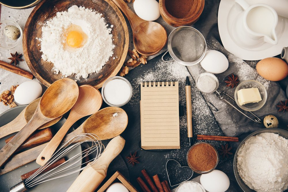 overhead-view-of-baking-ingredients-and-a-notepad-royalty-free-image-930086476-1546440806.jpg