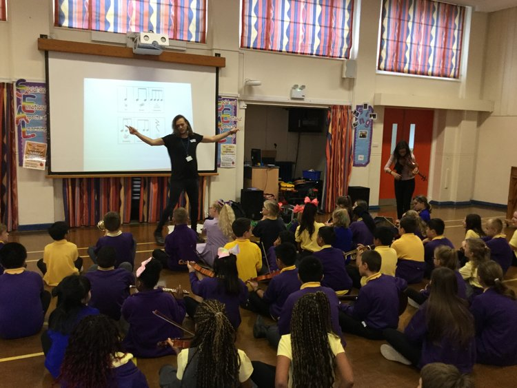 Year six pupils taking part in a workshop ahead of the iPad Concerto debut performance