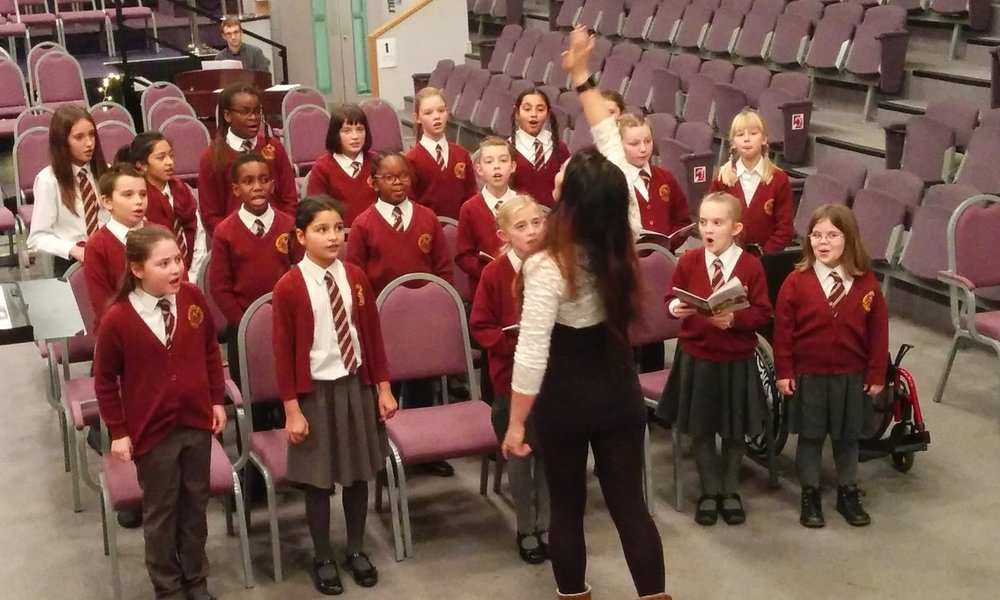 Singers from Springhil school rehearsing for their performance at Central Hall