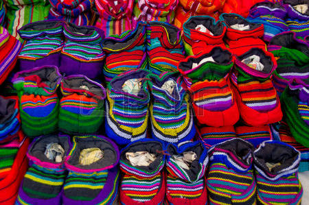 31912359-traditional-mayan-textiles-on-s-msrket-stall-in-antigua-guatemala-baby-shoes.jpg
