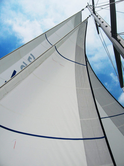 Roller furling Dacron forstaysail and genoa. Notice how the blue rolling furling cover wraps around the edge of the leech to fully protect the dacron sail.