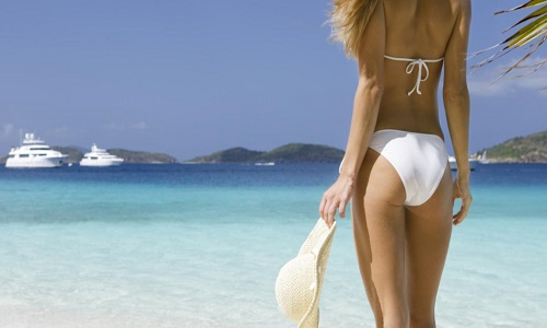 image-Woman-on-tropical-beach-with-yacht - Copy.jpg
