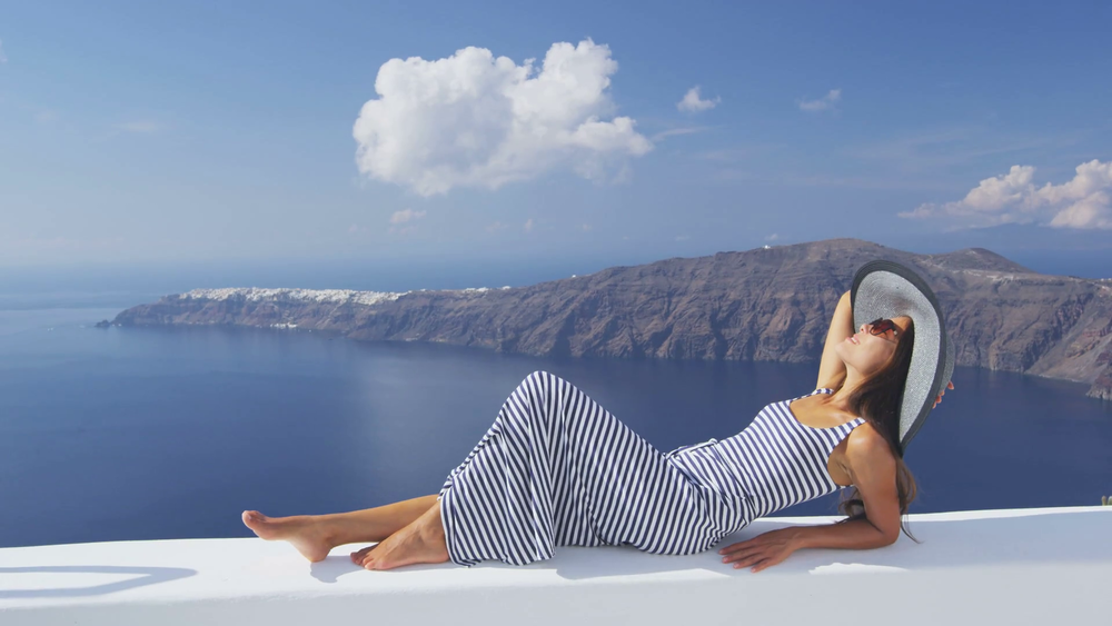 europe-greece-santorini-travel-vacation-woman-looking-at-view-on-famous-travel-destination-elegant-young-lady-living-fancy-jetset-lifestyle-wearing-dress-on-holidays-amazing-view-of-sea-and-caldera_s0mnhthrr.png