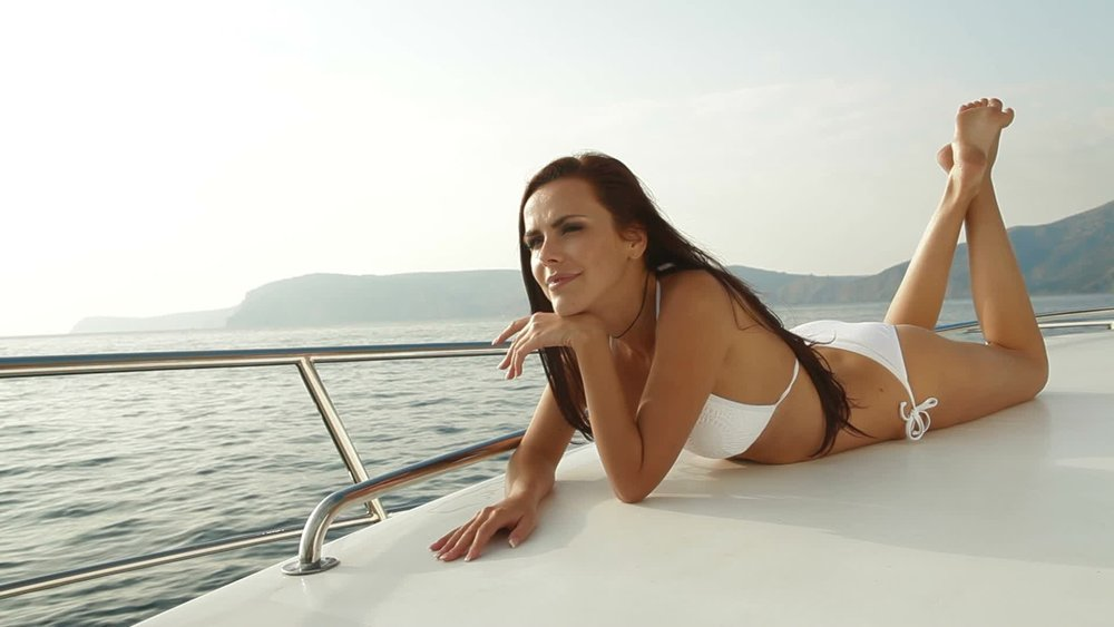 bikini-woman-luxury-yacht-footage-011898605_prevstill.jpeg