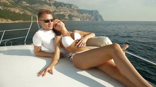 adult-couple-man-and-young-bikini-woman-relaxing-on-deck-of-speed-motor-boat-enjoying-mediterranean-summer-bay-vacation-yacht-cruise_eoqhuywig__S0000.jpg