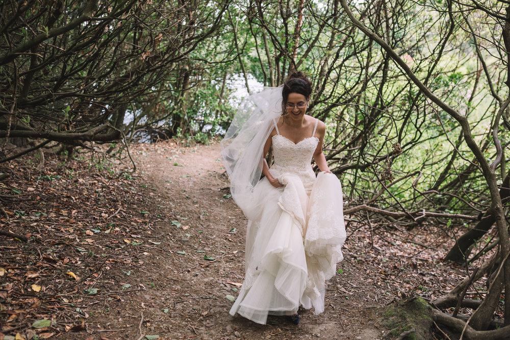 Bride running in woods