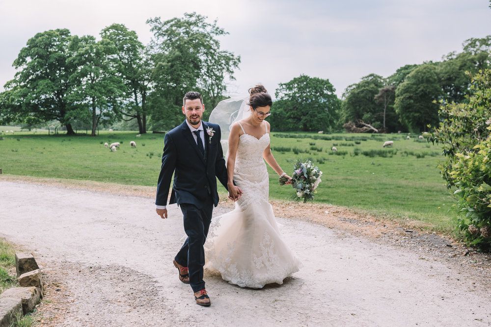 Contryside bride and groom walking
