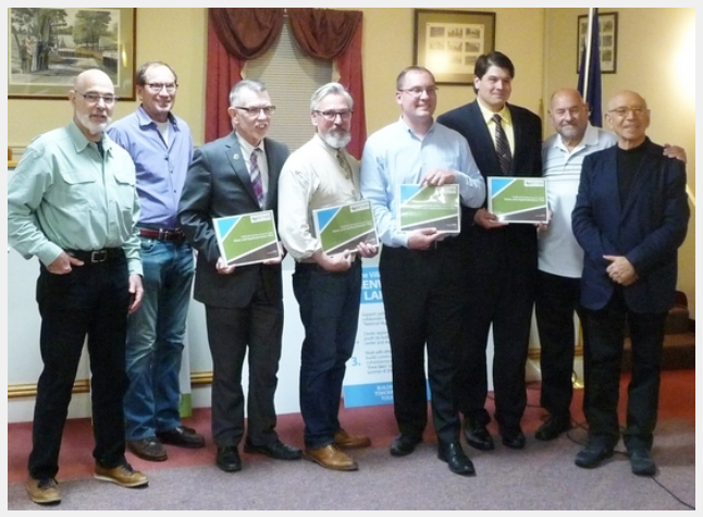Photo by Jonathan Talbot. Pictured left to right: Vision Co-chair Geoff Howard, Vision Co-chair Roger Moss,Warwick Town Supervisor Michael Sweeton, Village of Warwick Mayor Michael Newhard, Greenwood Lake Mayor Jesse Dwyer, Florida Mayor Daniel Harter Jr., Vision Co-chair Tony Trimarco, and Vision Consultant Gianni Longo.