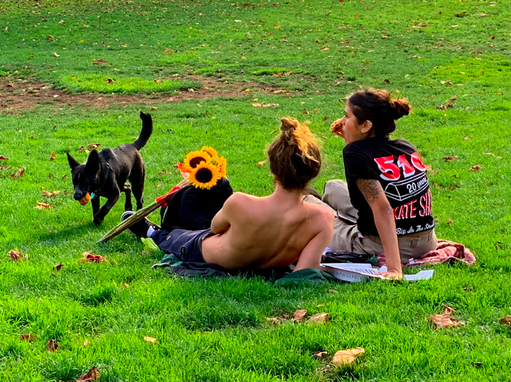 Cute couple in the park. It had all the makings of a cool picture, but never quite materialized…(and yes, this is hyper saturated. i was playing with attributes before deciding the photo just wasn't there.)