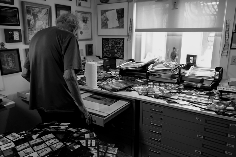 Uelsmann at home, his contact sheets spread out on worksurfaces to facilitate serendipitous seeing things.
