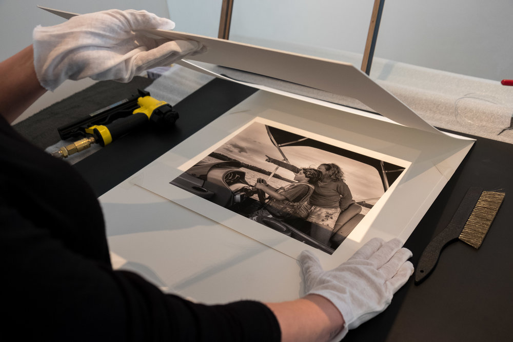 "Crafting an archival print is more than hitting ""print"" on a computer. Photographic artists can help create prints from your images. It transforms a moment into something different, iconic perhaps, and produces an artifact from this experience."