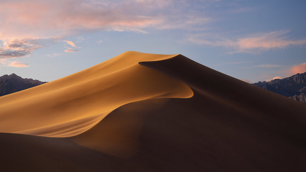 The Mac OS Mohave wallpaper photo, artist unknown, and hypothesized to be somewhere around Death Valley.