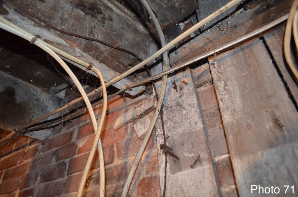 11 Floor joists pulling out of brick wall due to extreme sagging.png