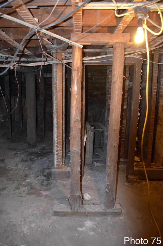 12 Existing improvised support beams in basement.png