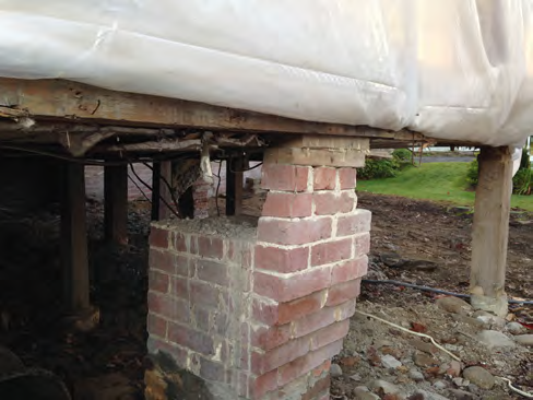 The original beam here may have been removed or damaged in a fire. The brick beam was removed and a new foundation and slab were installed in this area..png