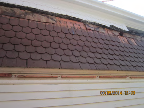 Restored cedar shingles emphasize another historic detail on the home..png
