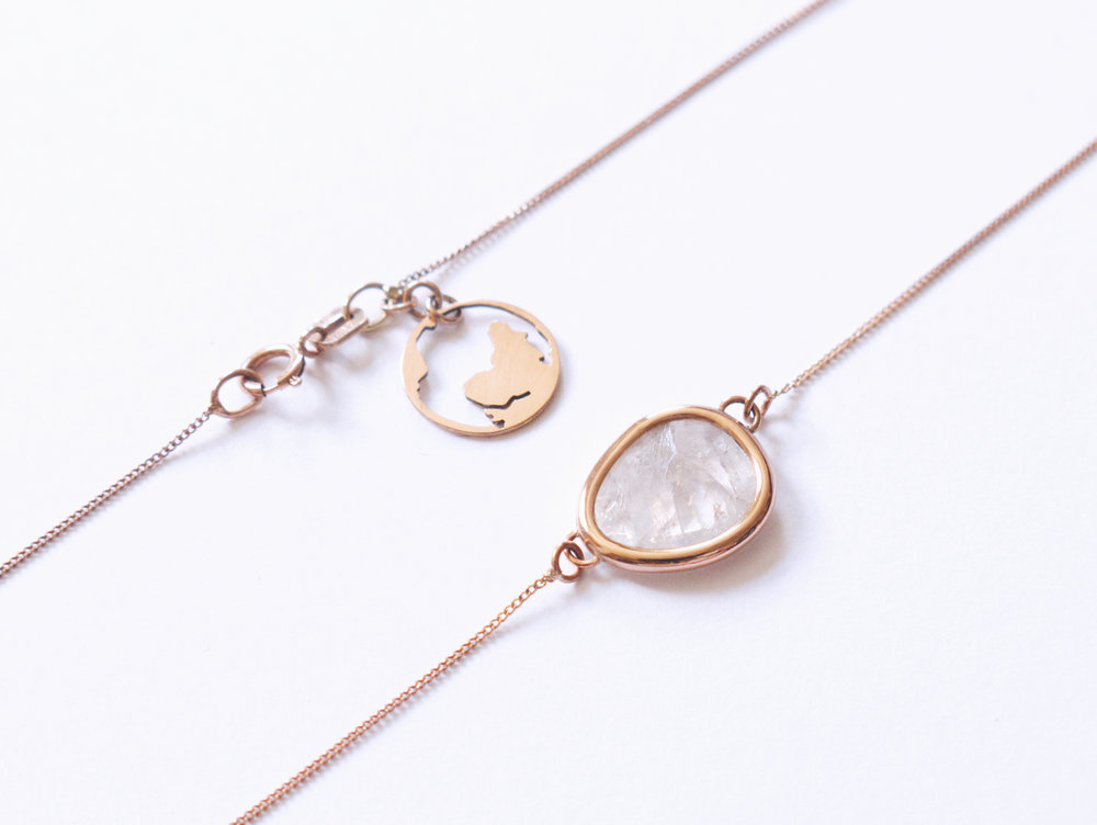 This bespoke necklace is made using 9ct Rose Gold and a free form rose cut rainbow moonstone. It was commissioned by a Mother as a gift for her daughter's 30th birthday. We talked on the phone, sent ideas back and forth and discussed sentimental ideas for the piece.