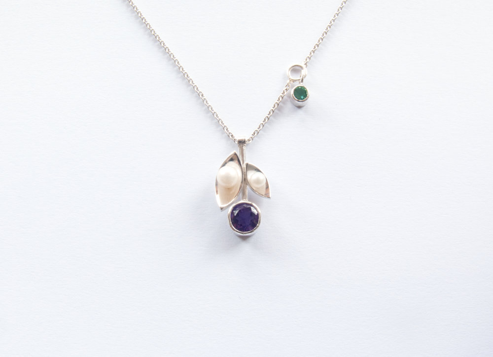 "This necklace was inspired by suffragette jewellery. Purple, white and green being the suffragette colours.  ""Purple as everyone knows is the royal colour. It stands for the royal blood that flows in the veins of every suffragette, the instinct of freedom and dignity…white stands for purity in private and public life[…]green is the colour of hope and the emblem of spring."" Mrs Pethick-Lawrence 1908"