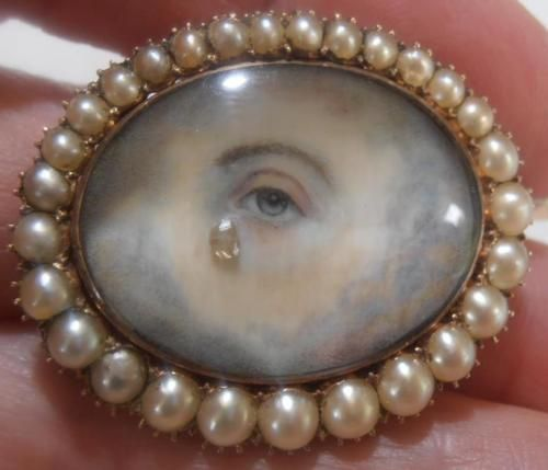 Brooch - painted eye, gold, diamond (tear drop) and pearls.