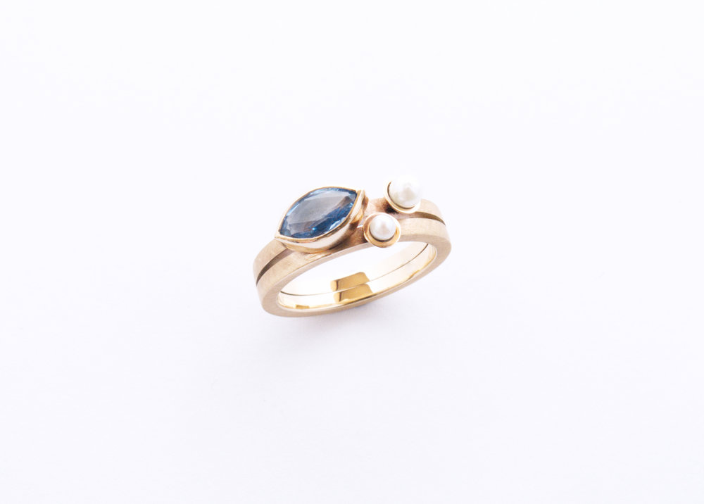 Sri Lankin marquise sapphire with two white saltwater pears. Set on top of a double square band in 9ct yellow gold.