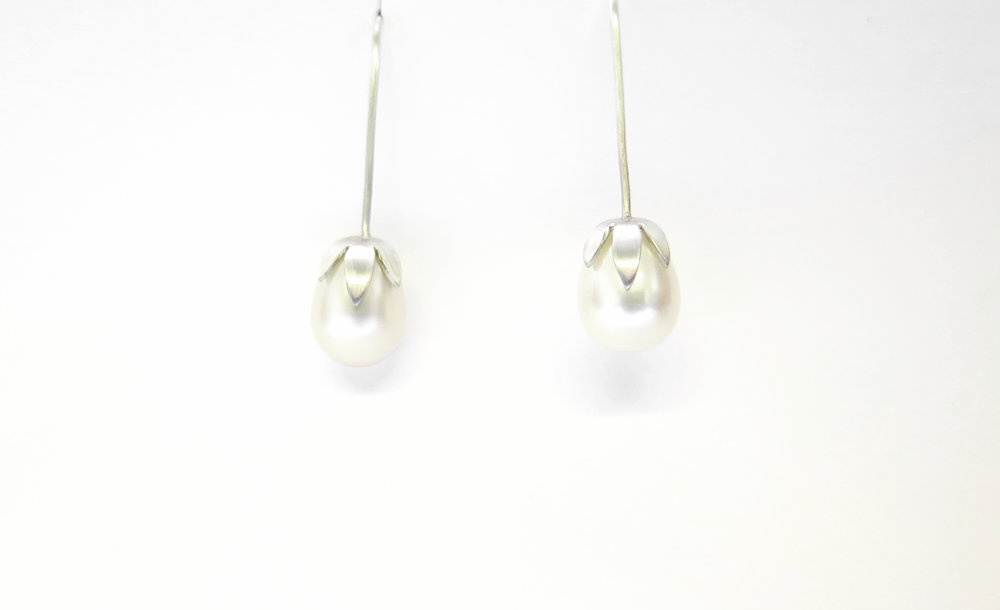 Pearl drop earrings for a pearl anniversary.