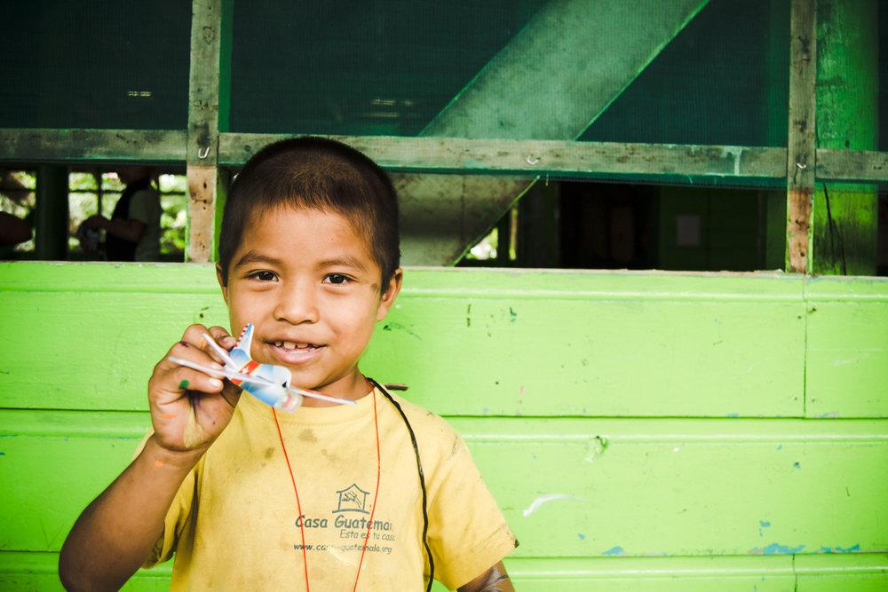 Casa-Guatemala_Boy-with-a-Toy-Plane.jpg