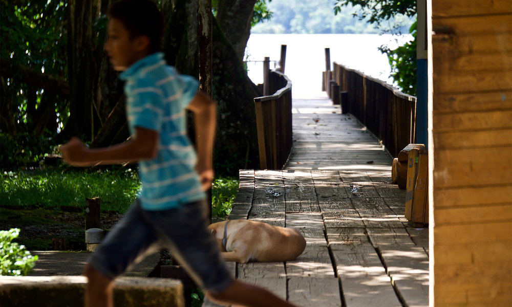 Casa-Guatemala_Boy-Running-Dog-Sleeping.jpg