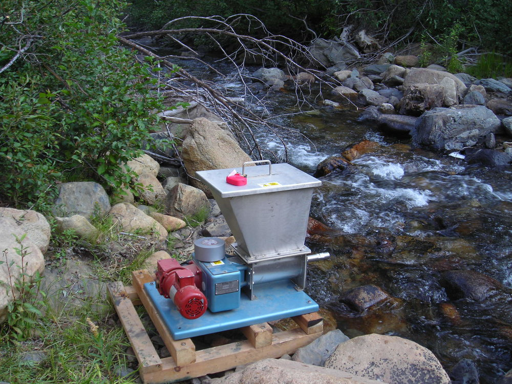 Photo of potassium permanganate dispenser that neutralized rotenone downstream from Silver Creek treatment area.  Credit: Chris McKibbin, Cal. Dept. of Fish and Wildlife