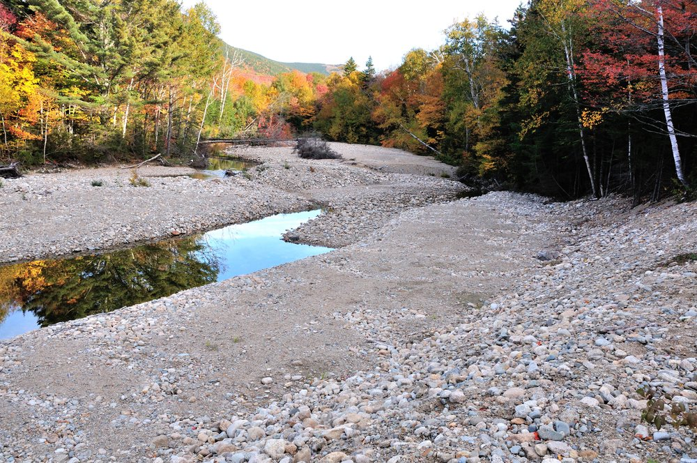 A tributary of the upper Ammonoosuc River. Similar, but less severe, damage can be found on the river itself. (Bob Mallard)