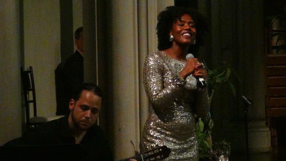 "Alicia Waller (soprano) and Stephen Flakus (guitarist) performed ""Manha de Carnaval"" by Luiz Bonfa and ""Quedate Luna"" by Devendra Banhart."