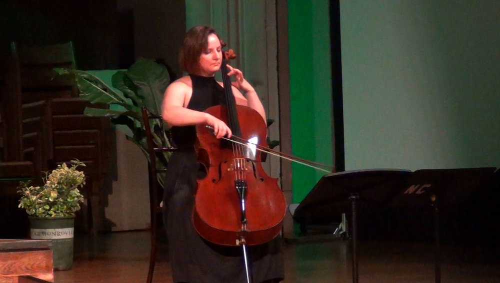 """Valeriya Sholokhova, cellist, performed a Casado Spanish Folk Melody and a duet with violinist Arthur Moeller performing """"Driving at Night,"""" written and composed by Richard Pearson Thomas."""