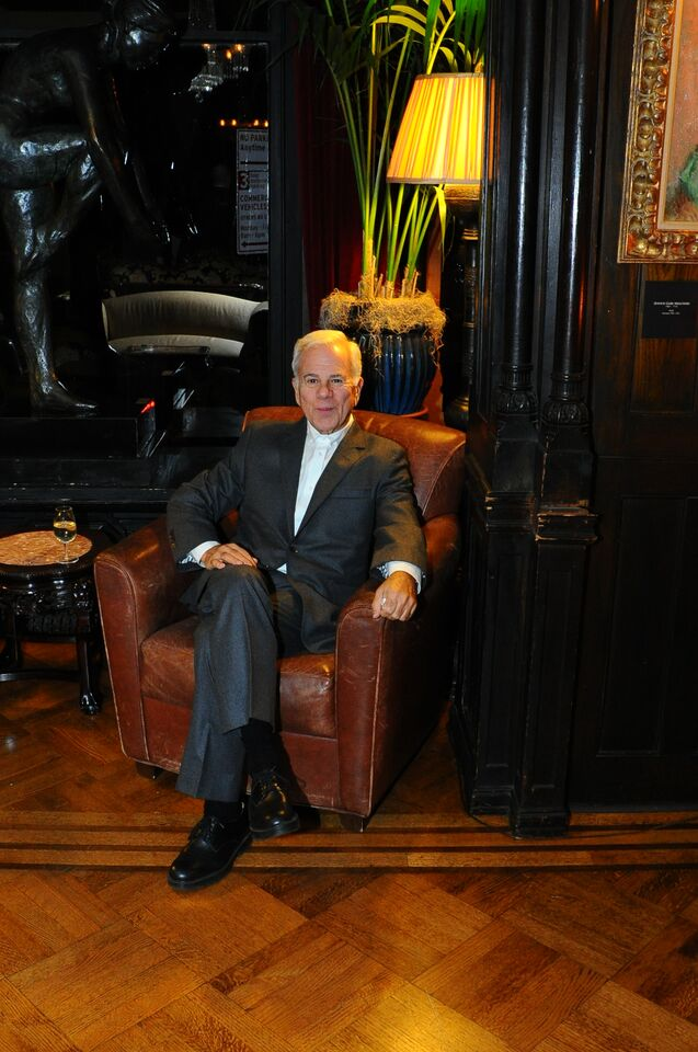 Dapper man in armchair.jpg