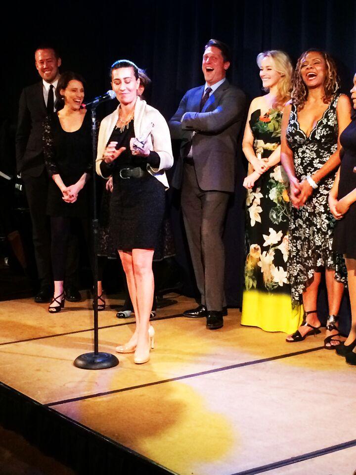 Jeanine appraises her award.jpg