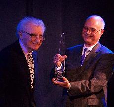 - Daniel handing Sheldon Award