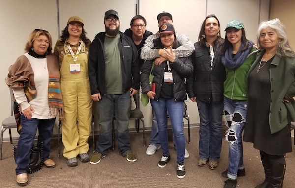 April 7, 2018—Winona LaDuke (third from the left) and Muriel YoungBear (center) gather with other indigenous hemp leaders for a picture at the NoCo Hemp Expo in Loveland, Colo.  (Image: Sarah LittleRedfeather)
