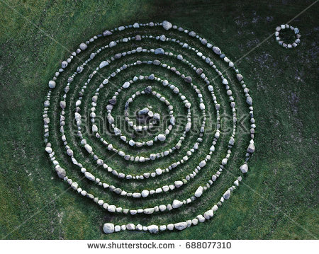 stock-photo-labyrinth-natural-spiral-from-stones-creative-artistic-labyrinth-688077310.jpg