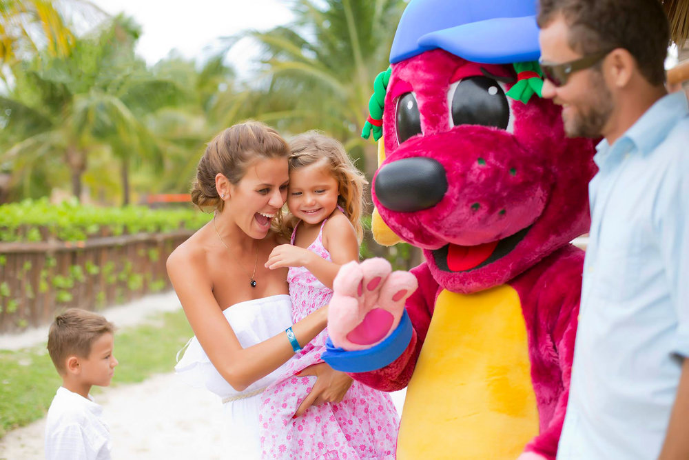 Trilby visits with a family at The Palladium Resorts.
