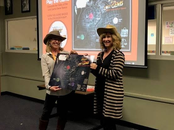 """Instructional technology leader, Melissa Grabarkewitz earns her """"Crusader"""" map poster, game sticker and a free lunch for completing the Game Basics activities."""