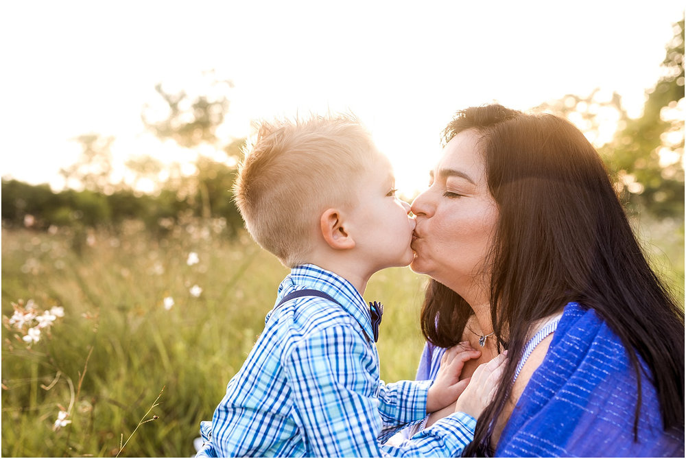 Houston, TX Family Photography featuring beautiful morning light. This sunrise session captures light, love, connection, and cuddles. Mama and son share a kiss.