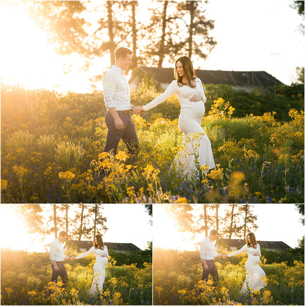 Houston, TX Outdoor Maternity Session with Golden Light, Mossy Trees, Texas Bluebonnets, and Summer Sunlight. Expectant couple looks stunning under a canopy of moss with beautiful golden sunlight. Mother to be embraced baby bump. Filed of wildflowers and bluebonnets surround this couple in Katy, TX.