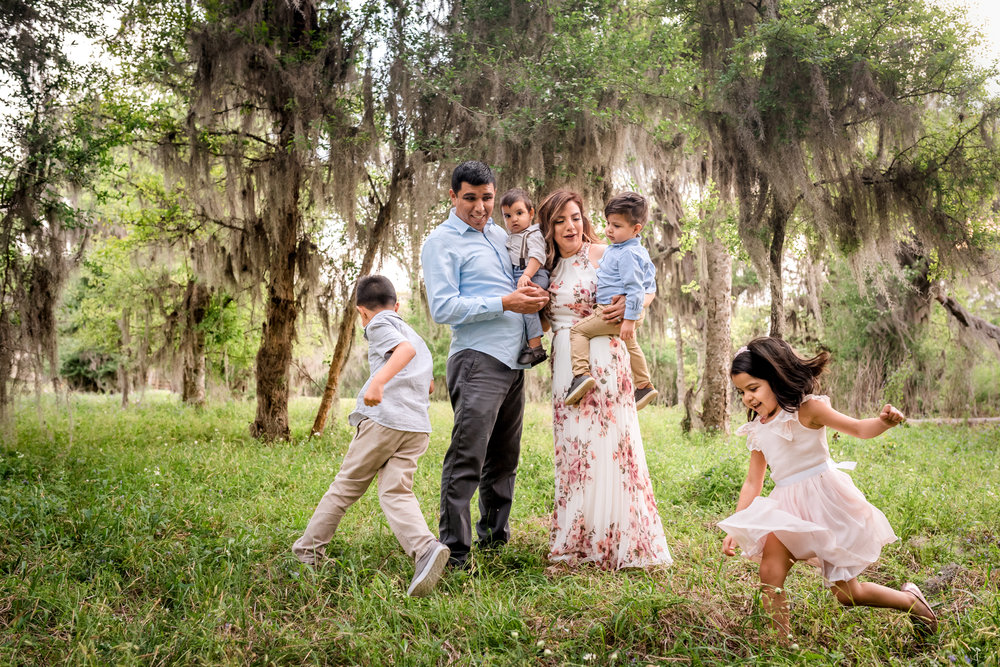 Outdoor Houston Family Photo Session with Golden Light, Mossy Trees, and Summer Sunlight.