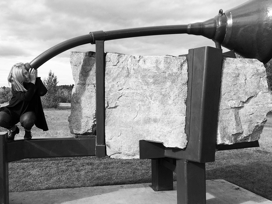 """Katherine trying out the sonic aspects of """"Beyond Listening"""" by Royden Mills, Terwillegar Park, Edmonton. Photo: MVHoy"""