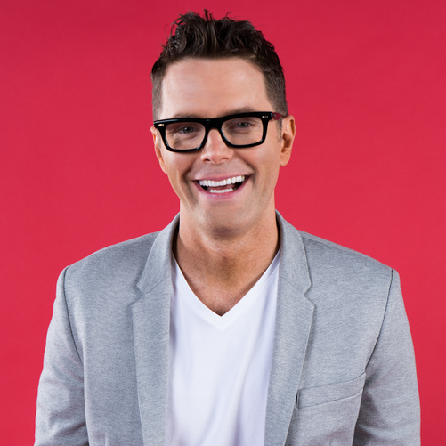 "Bobby Bones (iHeartMedia)   Radio DJ. Stand-up comedian. Best-selling author. Chart-topping recording artist. TV personality. Philanthropist. Bobby Bones has built his career on the ability to multi-task, turning humor, honesty, and hard work into a self-made business empire.  Long before launching ""The Bobby Bones Show""— the largest morning show in country radio— Bones grew up in Mountain Pine, Arkansas. It was a pint-sized town, supported by a saw mill that employed most of the area's residents. Bones had a different career in mind, though, landing his first radio job as a college student and, during the years that followed, bouncing between a handful of pop, hip-hop, and sports stations.  When ""The Bobby Bones Show"" — which launched in Austin, quickly establishing itself as the city's top-rated morning show — moved to Nashville and became a nationally-syndicated radio program in 2012, Bones' career hit hyperdrive. Country music was in his blood. He'd grown up with the stuff. Country music had expanded its boundaries since Bones' days in Mountain Pine, too, taking some inspiration from pop music and hip-hop along the way. No other DJ was better prepared to tackle that growing genre — a genre now reaching a new generation of fans who'd grown up with MTV, Napster, and the internet — than Bobby Bones. His impact hasn't gone unnoticed. He's since garnered prestigious accolades including a CMA Award for National Broadcast Personality of the Year and is a two-time recipient of the National Personality Award from the ACMs. He's also become the youngest ever inductee into the National Radio Hall Of Fame, joining radio legends such as Dick Clark, Howard Stern and more.  Overseeing a daily radio show requires teamwork, and Bobby has built his own team from the ground up, reaching out to friends and former interns — including longtime co-hosts Lunchbox and Amy — to join him in the studio. A strong family dynamic anchors ""The Bobby Bones Show,"" where visiting artists are encouraged to let their guard down and become, as Bobby says, ""the most human version of themselves."" There's no pageantry, no showbiz, no smoke and mirrors. Instead, Bones treats everyone like a member of the family, pulling real emotion out of the genre's biggest stars.  Of course, all of that teamwork and collaboration hasn't stopped him from regularly hitting the stage alone as a stand-up comedian. It's a job he's enjoyed since his teenage years. It continues to be a welcome challenge, too, putting Bones face-to-face with his audience and eliminating his cast of on-air sidekicks.  Bones shares a similar mix of personal stories and off-the-wall anecdotes in his first book, Bare Bones: I'm Not Lonely If You're Reading This Book. Published in 2016, the book topped several best-sellers lists upon its release, including the New York Times, USA Today, and the Wall Street Journal. Kicking off with memories of his childhood days in a Mountain Pine trailer park, Bare  Bones takes an unflinchingly candid look at Bones' life, even shining a light on the struggles he faced while growing up in a broken home. Bones isn't looking for sympathy; instead, he's reaching out to others who may find themselves in similar situations, having an addicted parent or challenged by the limited horizons of a small, rural town. Bones' story is the American Dream, and his goal is to encourage others to live their own version of that same dream. Bones will continue to inspire with his eagerly awaited second book, hitting shelves in Summer 2018.  With a consistent aim to give back, Bones' charitable efforts have helped raise millions for needy children, shelter animals, hospital patients, and victims of natural disasters. From his annual ""Pimpin Joy"" movement on ""The Bobby Bones Show"" to his work with organizations like Musicians On Call, St. Jude Children's Research Hospital, and the National Humane Society, Bones has encouraged a high level of charitable involvement amongst his listeners, while also walking the walk himself.  Bobby Bones and The Raging Idiots, the comedy-country band founded by Bones and his ""Bobby Bones Show"" sidekick, Eddie, started off as an excuse to play a handful of lighthearted songs at local charity events quickly snowballed into a genuine musical project, with multiple sold-out shows and studio collaborations with singers like Carrie Underwood, Garth Brooks, and Brad Paisley. Bones, who co-writes the band's material and handles lead vocals, insists that the Raging Idiots aren't meant to be taken too seriously. ""Just look at our name!"" he says, laughing. ""We're idiots! Don't take us seriously, please."" That didn't stop the band's first release, The Critics Give It 5 Stars, from becoming a crossover smash, topping the Billboard Comedy Chart and debuting at Number 4 on the Country Chart. Another release — The Raging Kidiots EP, a children's project aimed at younger listeners — spent two weeks at Number 1 on the iTunes Kids Chart. The Raging Idiots also released a full-length album titled Kiddy Up that debuted at #1. Serious or not, the Raging Idiots have become seriously popular.  Bones, too, has become increasingly popular since taking that first radio job in Arkansas with an audience of more than 5 million. He still kicks off every weekday morning as a radio host, but he's become much more than that, maintaining a multimedia presence that reaches beyond the FM airwaves. He's on your TV, on the air, on your bookshelf, in your CD player and onstage. He's Bobby Bones, and he isn't going anywhere."