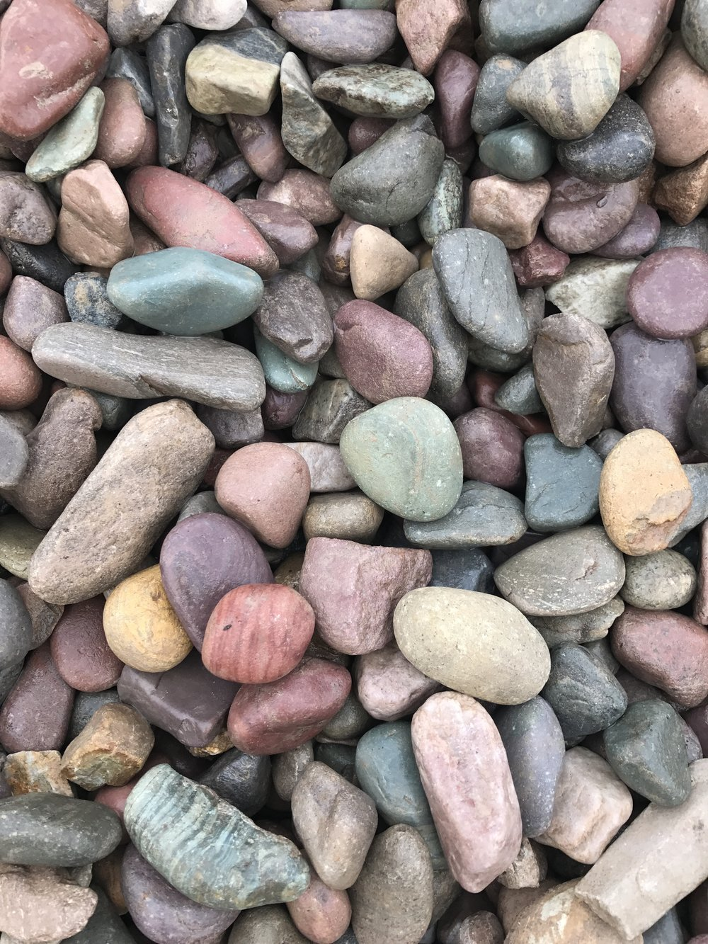 Our natural rainbow river rock is well-known for it's beautiful multi-colored reds, blues, purples, greens, and pinks. We sort rocks into various sizes so you can easily find the rock to suit your project. -