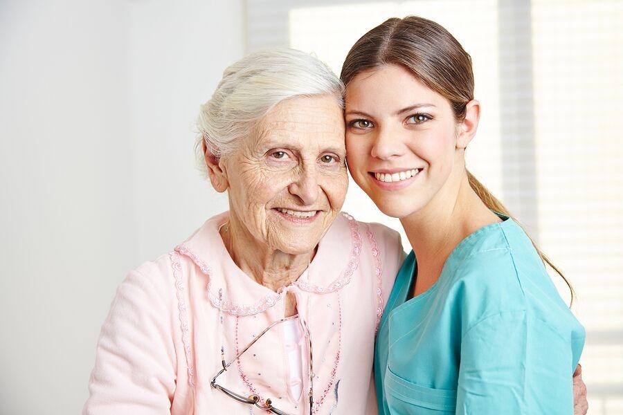 bigstock-Smiling-caregiver-embracing-ha-54611003_preview.jpeg