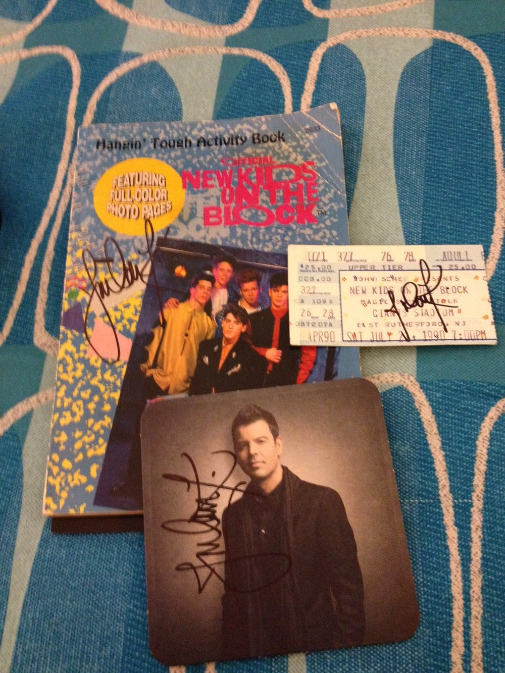 This photo has a few things I had signed by Jordan Knight during a hangout he had during the Nick & Knight tour a few years back. The hangout was a special meet and greet he did during the tour that included an individual photo with Jordan, opportunity to take selfies and get memorabilia signed, and some time to chat with him briefly as he went table to table to greet the fans. I had him sign an old NKOTB activity book, one of our tickets from the Magic Summer Tour I still had, and his coaster from the 10 Box Set.